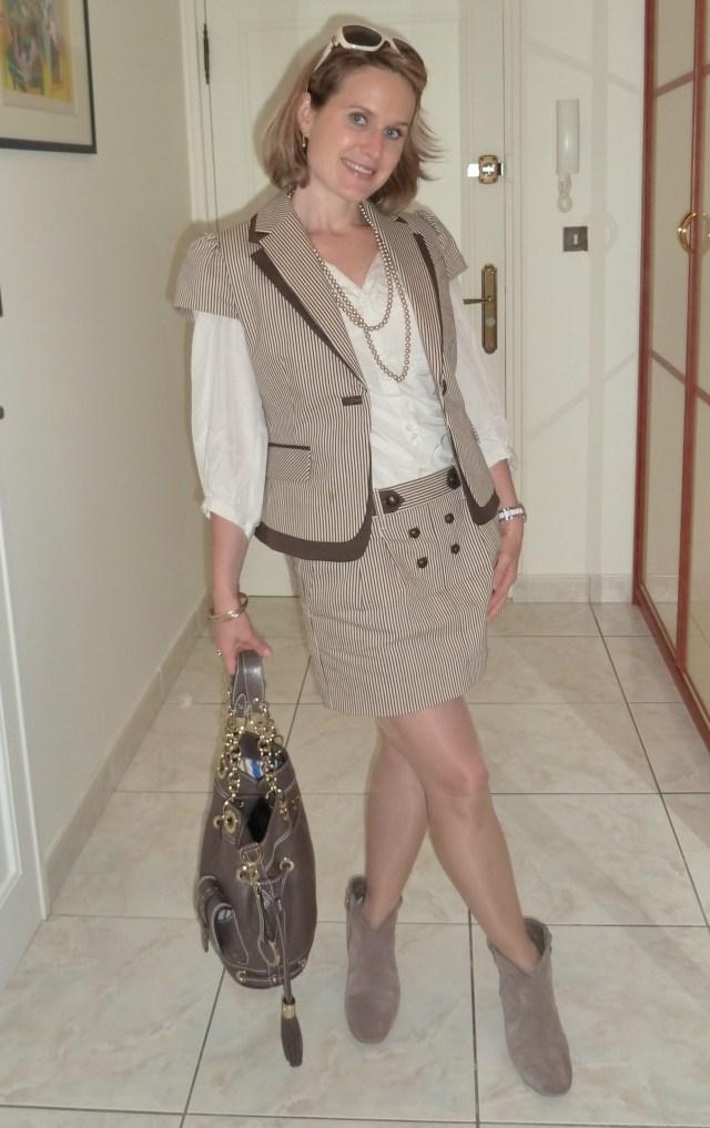 Jacket & skirt by BCBG Max Azria Shirt by Gérard Darel Handbag by Lancel Boots by Ash Sunglasses by Gucci