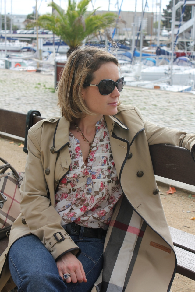 Sunglasses by Prada  Trench by Burberry Blouse by Vero Moda Jeans by Guess